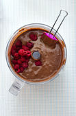 Making Cake - Mixing chocolate batter with raspberries — Stock Photo