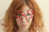 Superhero girl wearing mask with strawberries — Stock Photo