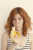 Young Woman Eating a Banana — Stok fotoğraf