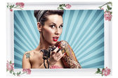 Pin-Up girl with tattoos — Stock Photo