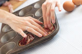 Making paleolithic muffins for breakfast — Stock Photo