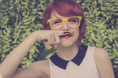 Cute hipster teenage girl with mustache, retro styled imagery — Stock Photo