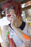 Cute hipster girl in a coffee shop — Stock Photo