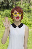 Cute hipster teenage girl showing a smiley face — Foto de Stock