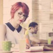 Cute hipster girl studying. Retro tones — Stock Photo #49010175