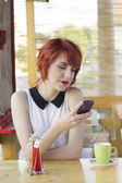 Cute hipster girl texting — Stock Photo