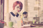 Cute hipster girl studying. Retro tones — Stock Photo