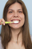 Beautiful woman brushing teeth  — Stock Photo