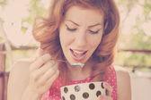 Beautiful Pin-Up Girl eating ice cream, close up — Stock Photo