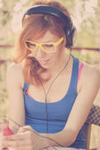 Beautiful hipster girl with big headphones listening to the music — ストック写真