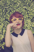 Cute hipster girl with mustache — Stock Photo