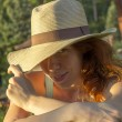 Shy girl in a summer hat enjoying the sun — Stock Photo #50808937