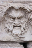 Mad face sculpture — Stock Photo