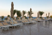 The sun loungers on the coast — Stock Photo