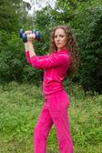 Sporty woman with  dumbbells — Photo