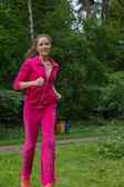 Woman jogging outdoors — Foto Stock