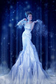 Snow Queen in the forest creates a blizzard — Stock Photo