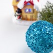 Branch of a Christmas tree and blue ball and ribbon — Stock Photo #43086797