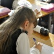 Close up of a schoolgirl writing something — Stock Photo #43087885