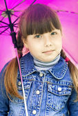 Small girl under umbrella — Stock Photo