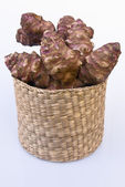 Jerusalem artichoke root with basket (Helianthus tuberosus) — Stock Photo