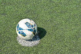 Old football at penalty mark — Photo