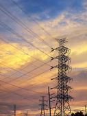 High voltage poles silhouette — Stock Photo