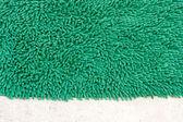 Green doormat — Stock Photo