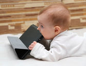 Baby explores his tablet computer — Photo