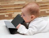 Baby explores his tablet computer — Photo