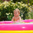 Funny little boy playing with water in baby pool — Stock Photo #51185389