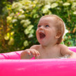 Little boy playing in baby pool — Stock Photo #51334339