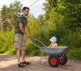 Handsome man transporting little baby — Stock Photo
