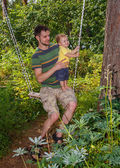 Young father and his little son swinging — Stock Photo