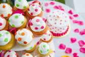 Colorful wedding cupcakes tier — Stock Photo