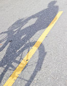 Shadow of a man riding  bicycle — Stock Photo