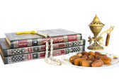 The holy Quran with oudh burner islamic prayer beads and dates p — Stock Photo