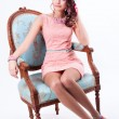 Beautiful girl in the Spring image sits on a chair in baroque st — Stock Photo