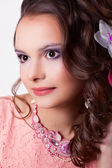 Portrait of a woman with make-up with pink decoration technique — Stock Photo