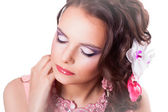Beautiful purple makeup on the girl with closed eyes in a pink d — Stock Photo