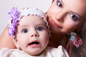 Six-month daughter with her mother surprised — Stock Photo