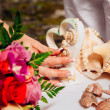 Wedding rings on sea shells — Stock Photo