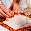 Newlyweds signing marriage license or wedding contract — Stock Photo