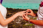 Groom put a ring on finger of his wife — Stock Photo