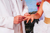 Groom put a ring on finger of his lovely wife — Stock Photo