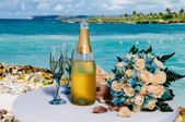 Decorative glass of champagne on a decoration table — Stock Photo