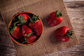 Strawberry in a clay bowl — Stock Photo