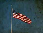 American flag waving on blue sly — Zdjęcie stockowe
