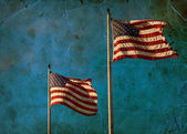 American flags waving on blue sly — Stock Photo