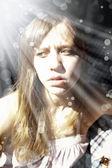 Attractive Caucasian woman looking sad — Stock Photo